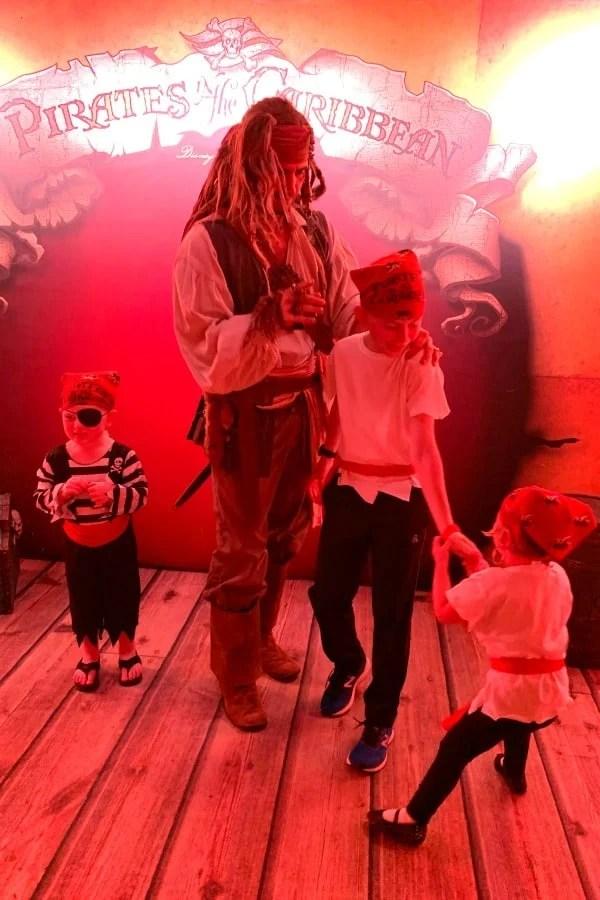 Kids meeting Captain Jack Sparrow during Disney Cruise Pirate Night