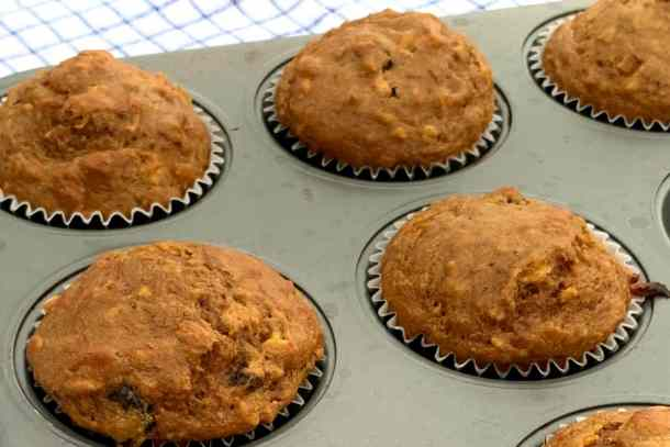 Muffin pan full of healthy bran muffins