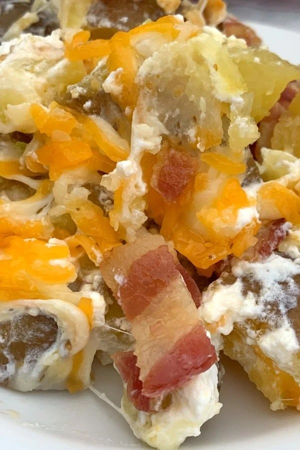 Baked potatoes cut into cubes and covered in bacon, sour cream and cheese