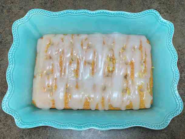 Holes in Pina Colada Poke Cake with sweetened condensed milk and cream of coconut soaking in the white cake