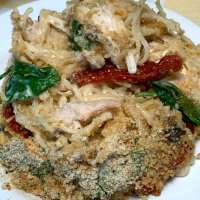 Tuscan Chicken Casserole covered with Italian bread crumbs and parmesan cheese