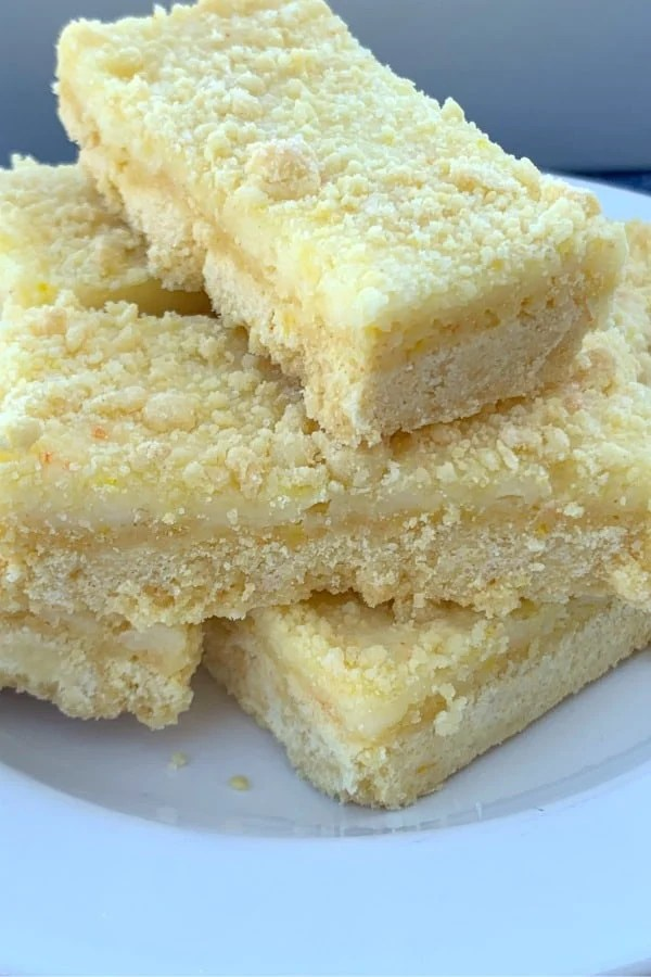 Easy cheesecake cookie bars made from a box mix
