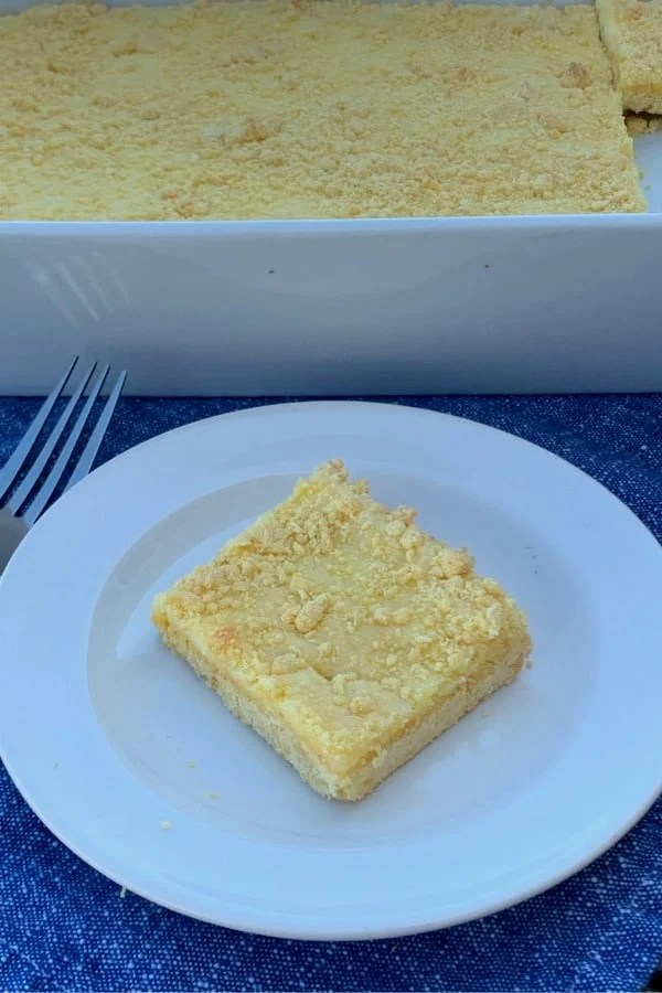 Square Cheesecake cookie bar on a white plate