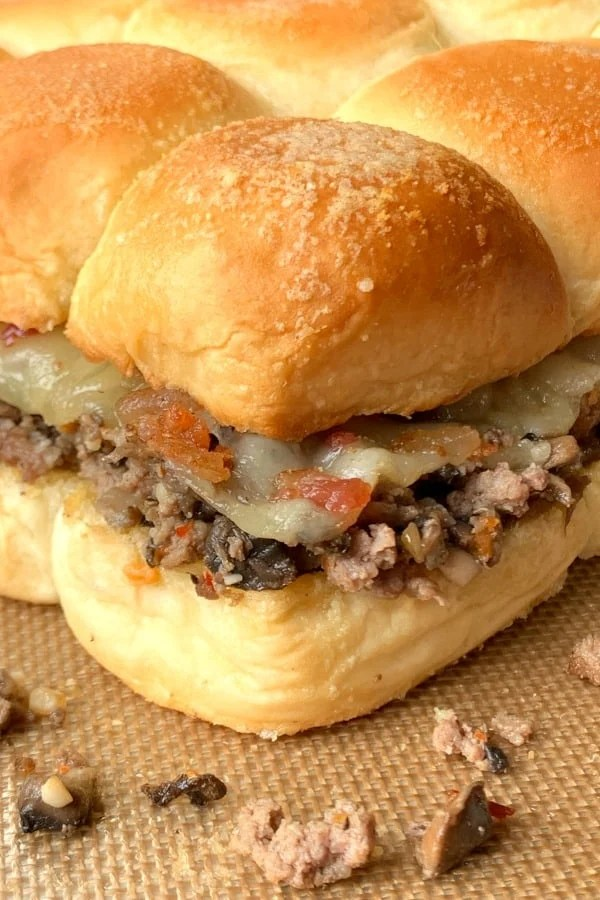 Butter Hawaiian sliders with ground beef, Swiss cheese and bacon bits