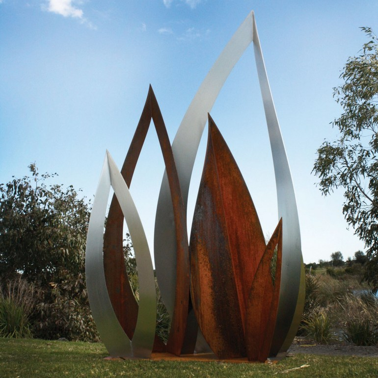 Hollow Leaf Corten steel sculpture in garden by PLR Design