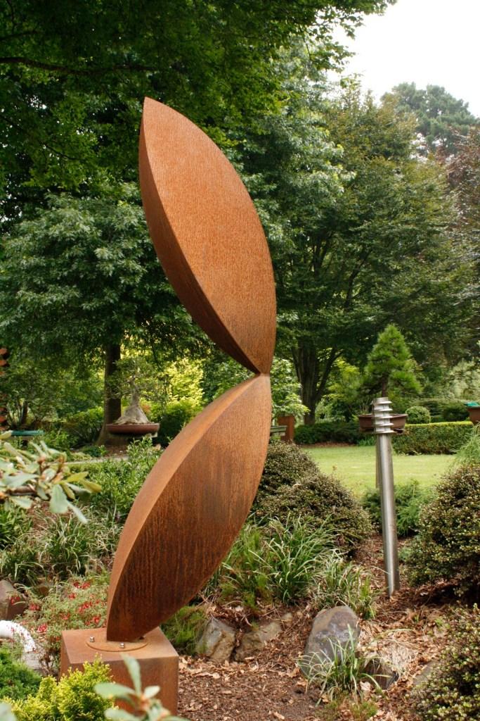 Corten steel sculpture in garden by PLR Design