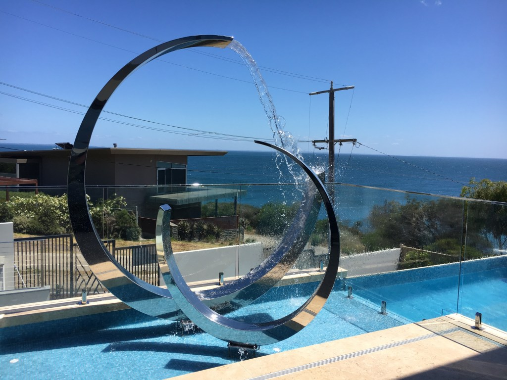 polished steel sculpture by 3 point engineering