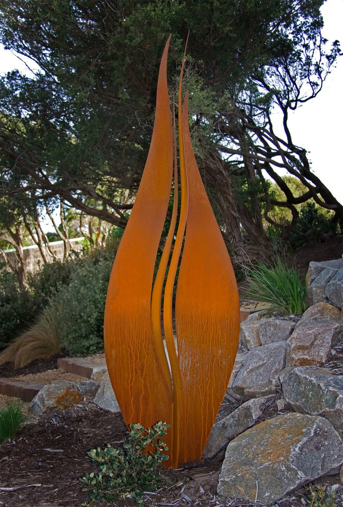 Twin Flame Corten steel sculpture in garden by PLR Design