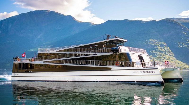 A futuristic electric ferry sails in the fjords of Norway