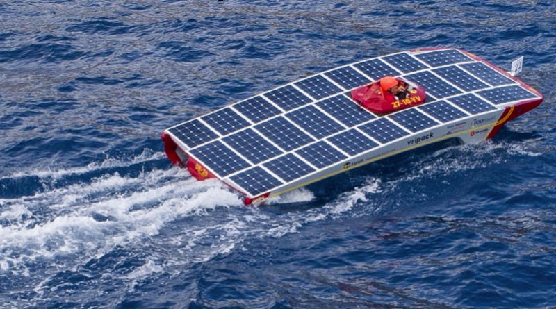 a solar powered boat cuts through the water