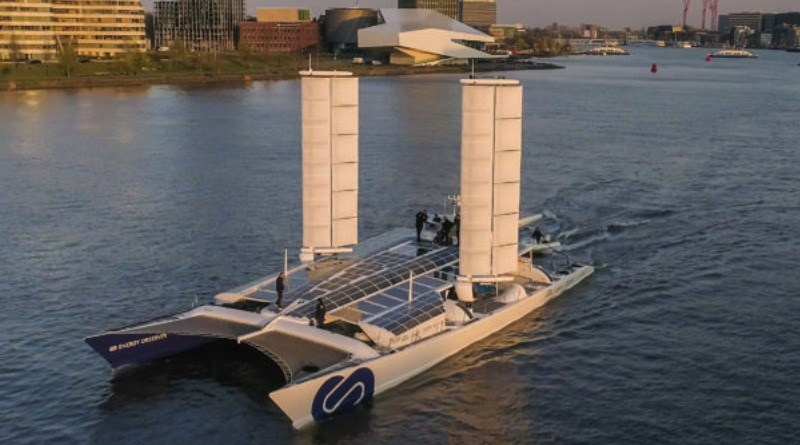 A large catamaran boat with two huge pillars on each deck that are sailwings