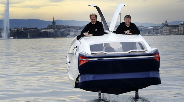 Alain Thebault and Anders Bringdal smile as they ride their hydrofoiling water taxi in Paris