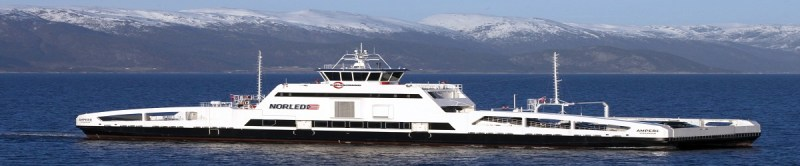 a long electric car ferry with Norway's fjords in the background