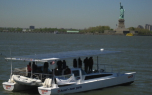 Solar Boat Sun21 sails past the Statue of Liberty in 2007
