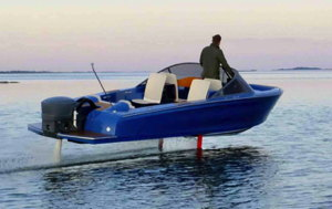 An electric boat 'flies' above the water on its hydrofoils '