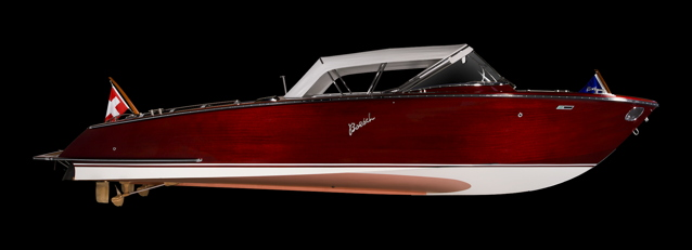 A classic runabout boat that is electric