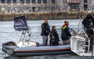 The man developing the world's fastest jetski, Jamie Marley, pilots a boat with GreatThunberg in Plymouth harbour