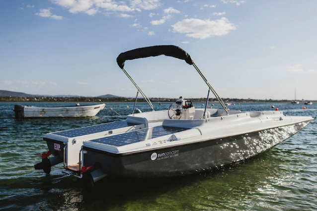 Runabout type boat with solar panels on its decks