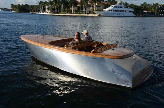 Electric runabout with aluminum hull and mahogany decks