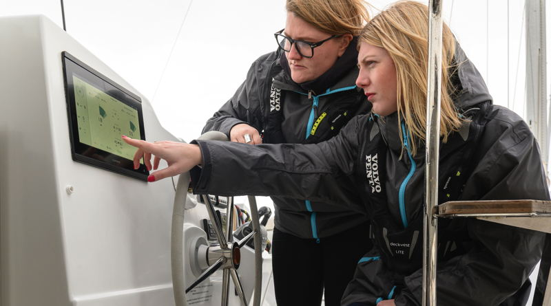 Two women look at the interface panel for the Volvo Penta electric boats