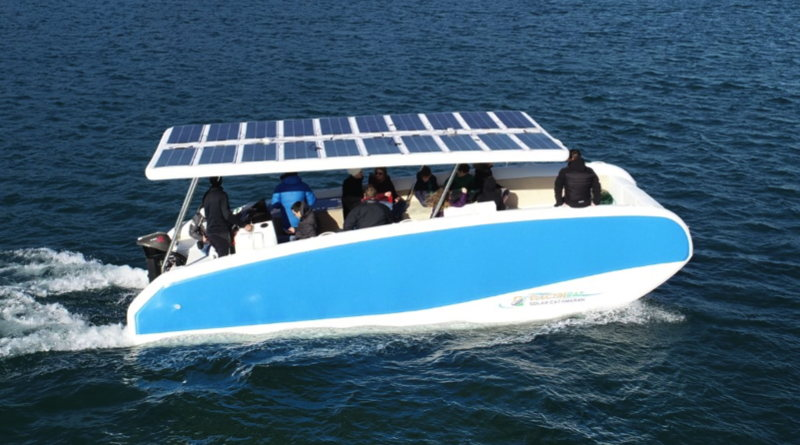 new inflatable solar boat cruising along in the water with passengers.