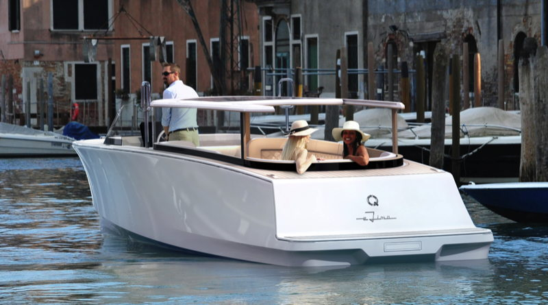 Chauffeur of a Q-Yachts electric boat eLimo takes two passengers along a European canal