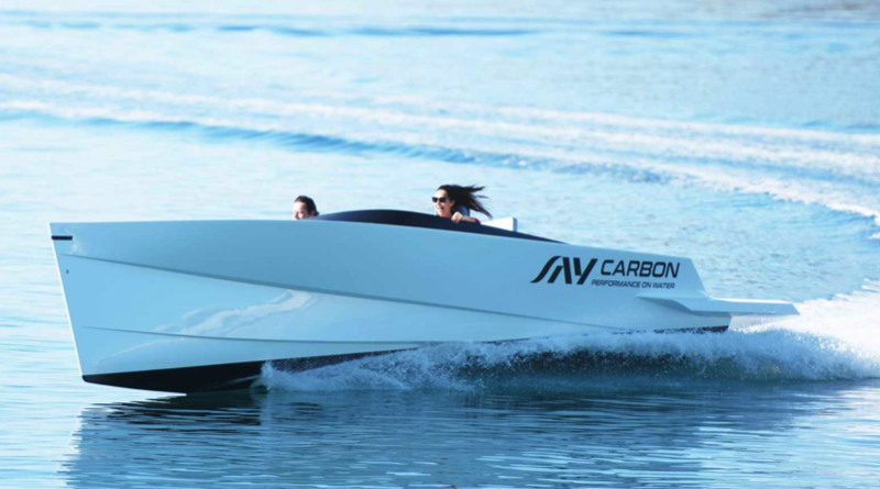 World's fastest electric boat speeds over the water leaving a wake