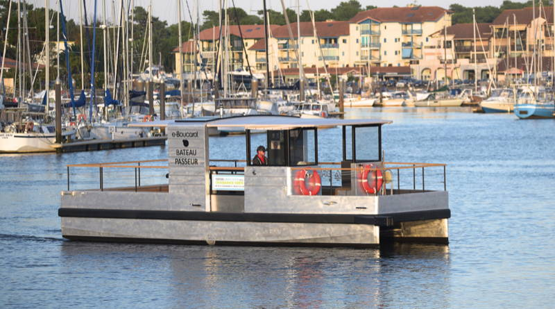 all-electric passnger ferry cruises across harbour of Caprbreton