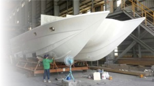 electric yacht China - a catamaran being built in a warehouse