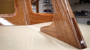 electric woodenboat close up of details where roof joins deck