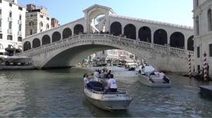e-regatta procession approaching The Rialto in Venice