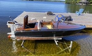 diy boat for electric boat awards - a n open top runabout at a dock