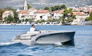 man out cruising in electric boat