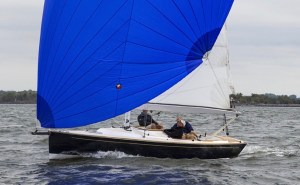 two people in a small sailing boat