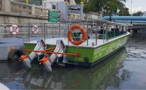 Electric passenger riverboat on dock in Bangkok