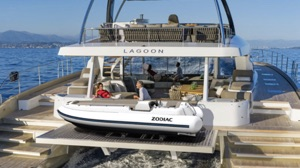 Zodiac electric boat 450 eJET on the back of a double story catamaran yacht