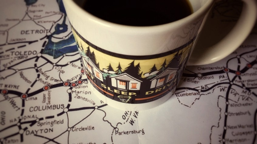 Map and mug. Get out and Drive Electric