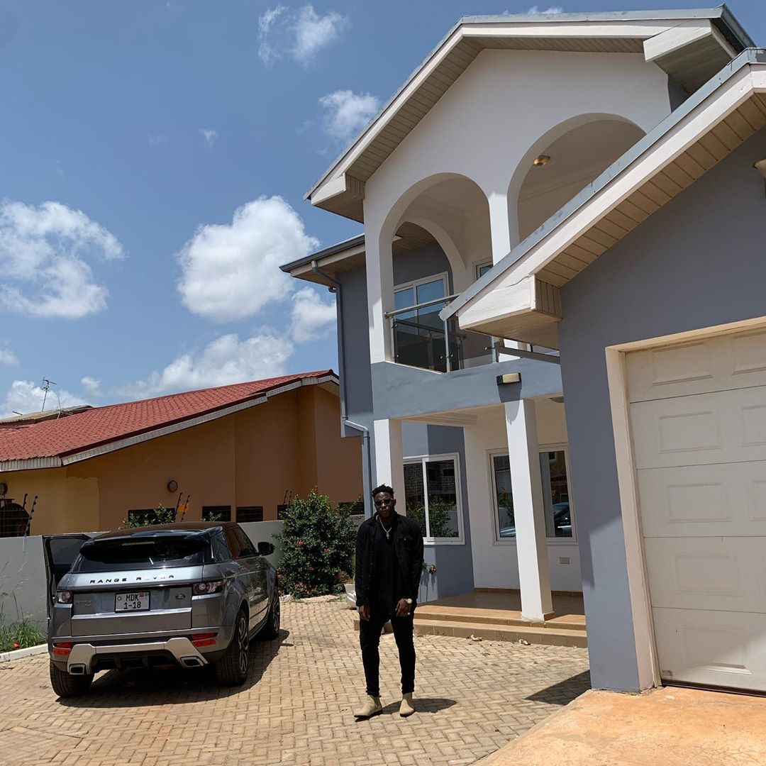 Medikal poses in front of his $1.2 million East Legon mansion