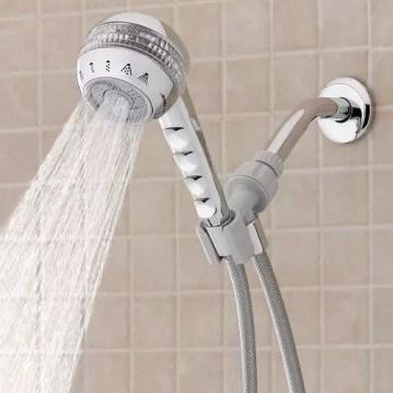 Handheld shower head in bathroom