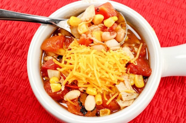 The Crockpot Chicken Chili recipe great to pop in the slow cooker in the morning before you leave for work or even the night before and start it up.