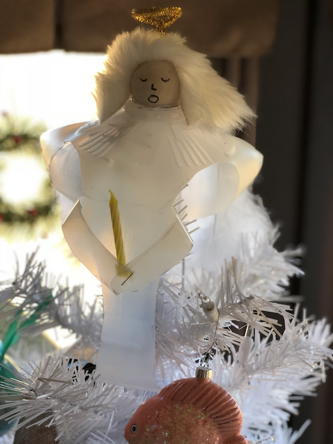 I can use the Milk Jug Angel on my table as a decoration on top of a flameless candle and the light shines through or as a tree top decoration.