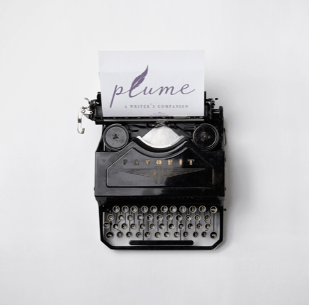 Typewriter with Plume logo on inserted piece of paper