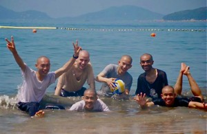 monks swimming