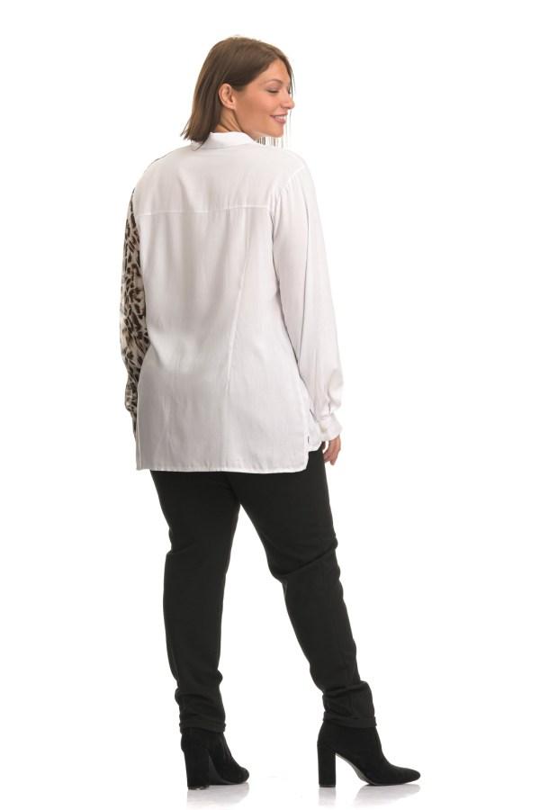 Πουκάμισο μεγάλα μεγέθη λευκό με λεοπάρ στη μια πλευρά .Στο eshop μας θα βρείτε οικονομικά γυναίκεια ρούχα σε μεγάλα μεγέθη και υπερμεγέθη.