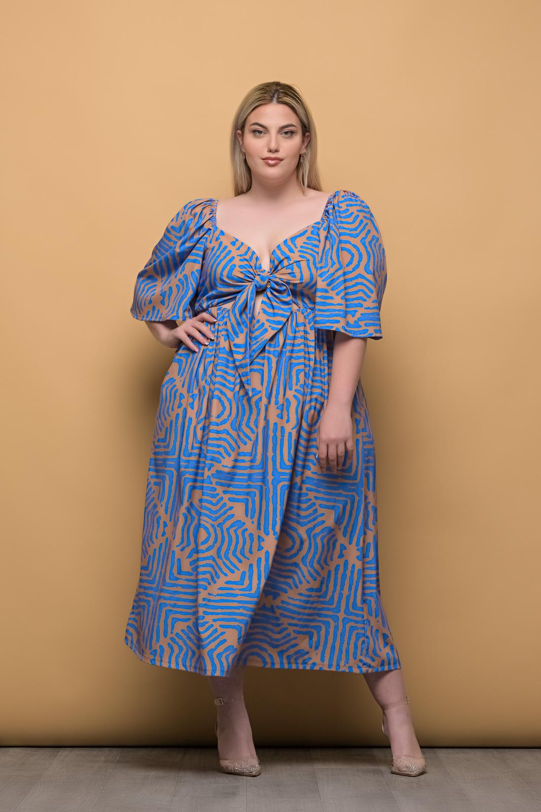 Φόρεμα μεγάλα μεγέθη εμπριμέ με δέσιμο στο στήθος και λάστιχο στη μέση.Στο eshop μας θα βρείτε οικονομικά γυναίκεια ρούχα σε μεγάλα μεγέθη και υπερμεγέθη.