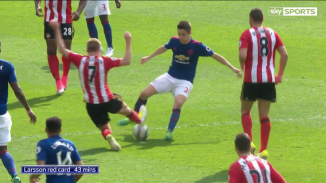 Larsson rushes in to tackle Herrera.