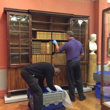 Removing the books from their storage in furniture