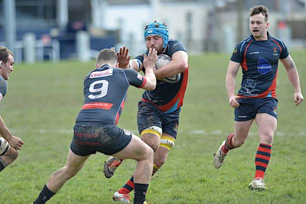 Devonport Services' Tyler Busfield charges at the Penryn defence (picture by Mark Andrews)