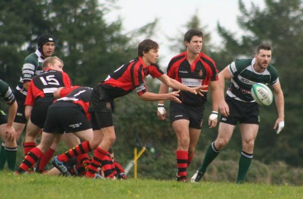 Tavistock pass the ball out against Plymouth Argaum