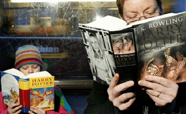 Image result for person reading harry potter book